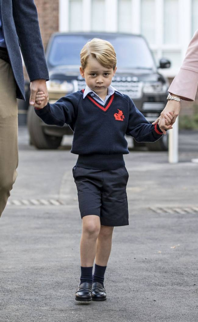 Prince George holding hands with the Duke of Cambridge and Helen Haslem, head of the lower school, at Thomas's Battersea in London, as he starts his first day of school. Image: Richard Pohle/The Times/PA Wire
