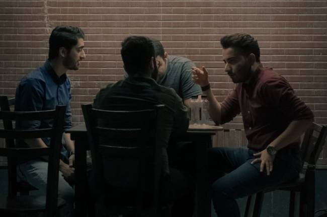 A group of men talking supporting one another