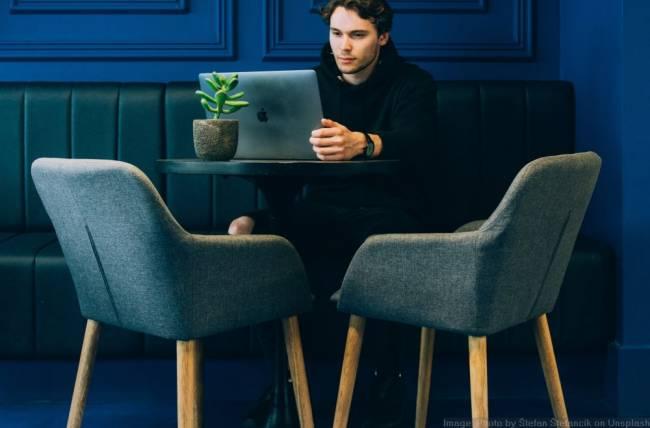 Man looking at csa options on his laptop