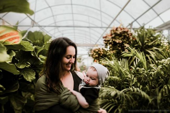 A mother and child in a greenhouse