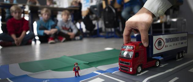 Toddlers learning the basics of road safety.
