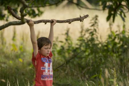 Child plays with stick. Image: National Trust