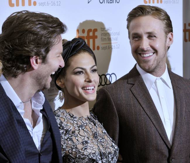 Gosling with his wife, actress Eva Mendes and actor Bradley Cooper. Image: Reuters
