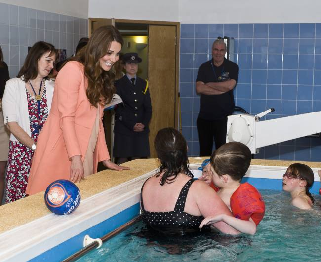 Duchess of Cambridge, speaks with staff and children in the hydrotherapy pool, during her visit to the Naomi House children's hospice in Sutton Scotney in 2013: Reuters
