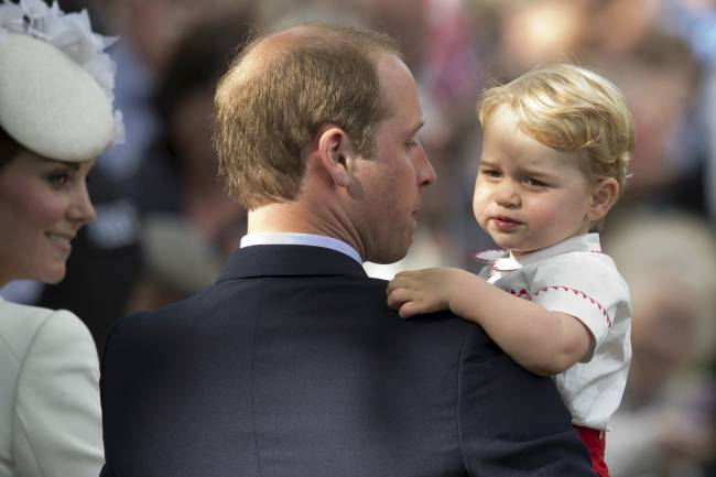 Prince William carries his son Prince George | Image: REUTERS