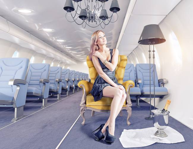 The stewardess was not fooled by Dominique's arms-as-a-seatbelt ruse | Image: ingimage
