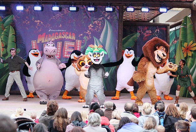 Dan (far left) forgets his penguin costume, but is pretty sure he's got away with it | Image: Chessington World of Adventures