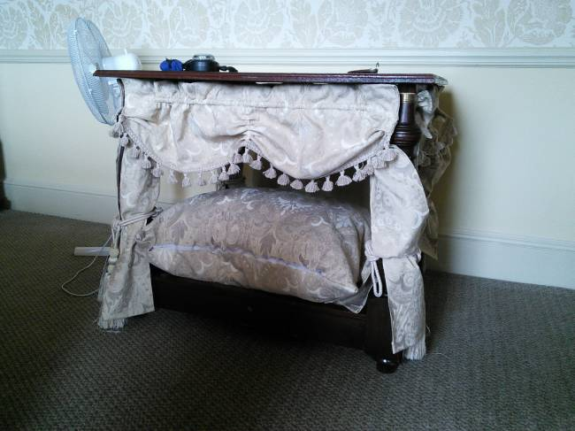 Four-poster doggy bed.