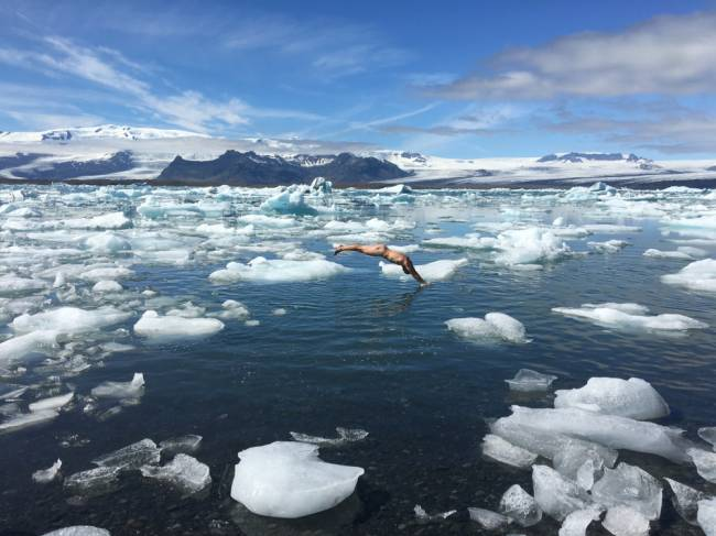 George takes a dip in the Arctic. | Image: Olly Hicks