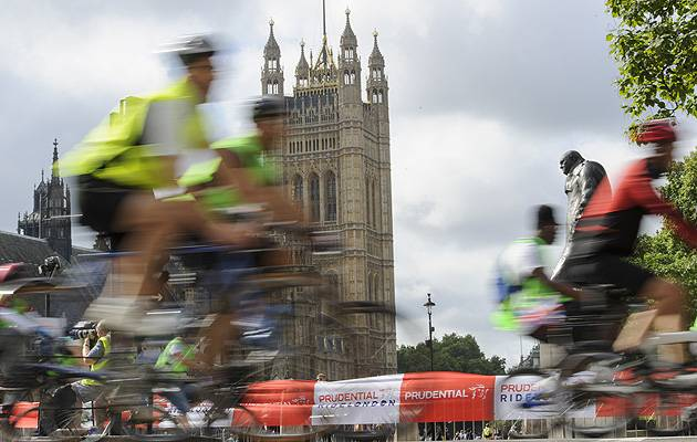 Wheelie good view: Those taking part in the gruelling London-Surrey 100 zip past the iconic clock formerly known as Big Ben | Image: Prudential RideLondon