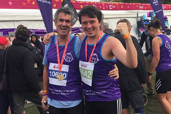 Lads and dads: Oliver and his father, Jim, celebrate completing the Royal Parks half marathon in October | Image: Julia Bellak