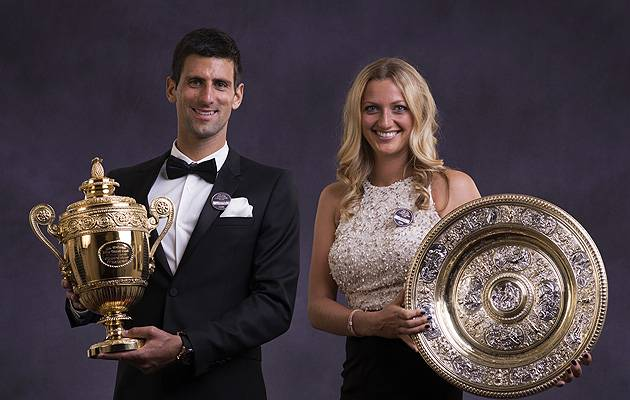 Having a ball: The 2014 winners, Novak Djokovic and Petra Kvitova, don their finest threads and show off their trophies | Image: All England Lawn Tennis and Croquet Club
