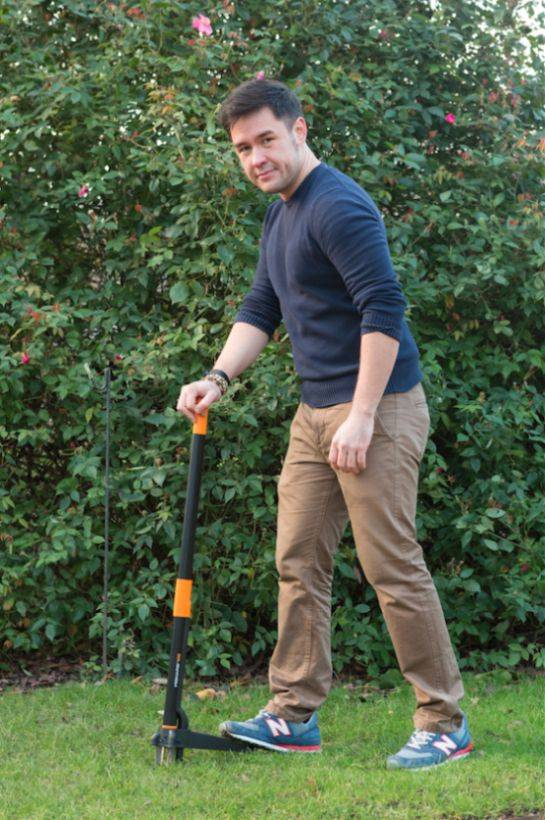 Man in garden holding a weed killer