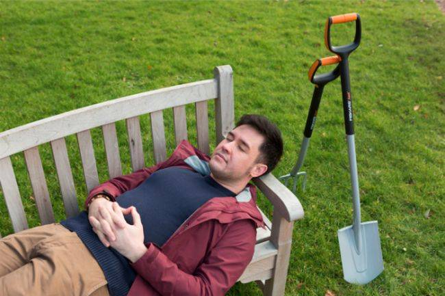 Man relaxing with eyes closed on a bench