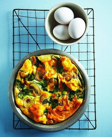 spinach and mushroom frittata on a cooling tray